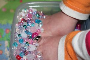 Sensory play with the beads.