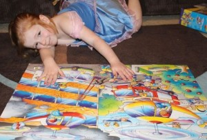 A proud of her helicopter rescue puzzle.