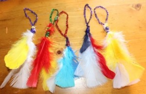 Feather and pipe-cleaner decorations.
