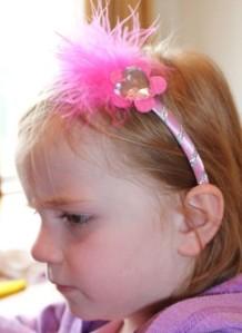 A modelling her headband.