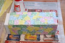Half-way through covering the box in paper, letting it dry.