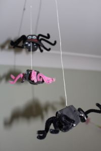 Spiders hanging from the ceiling.