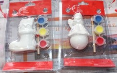 Christmas decoration kits, one boot and one angel.