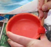 Painting the saucer.