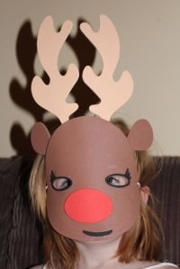A wearing her new reindeer mask.