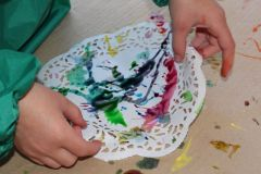 Tipping the doily to spread the colour.