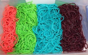 Red, green, blue and purple spaghetti.