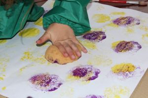 Using the sponge to make multi-layered art.