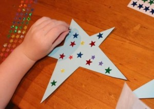 A placing star stickers.
