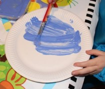 Painting the plate blue.