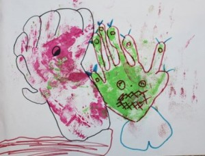 L's monster drawing using A's messy hand print painting.