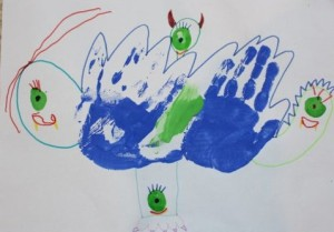 Two hand print monster with fingerprint eyes.