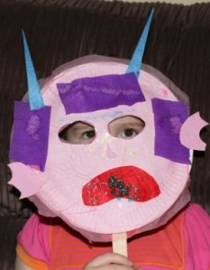 A modelling her monster mask.