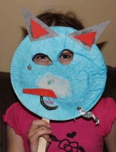 L modelling her monster mask.