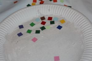 Placing the cardboard mosaics.