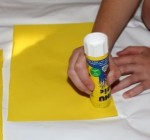 Gluing on the yellow paper.