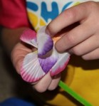 Placing the flower shapes onto a stem.
