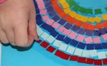 Placing mosaic squares.