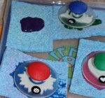 Paint and stamps on sponges ready for stamping.