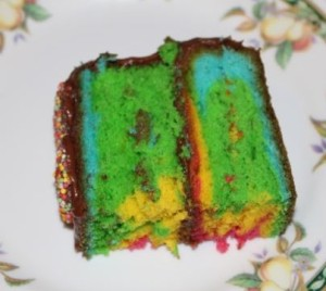 A slice of surprise rainbow cake.