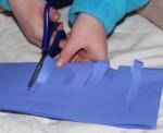 A cutting her paper.