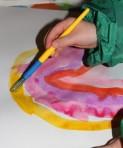 Painting a rainbow.