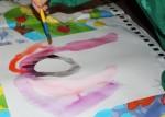 Painting rainbow hair.
