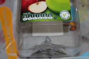 The slot at the base of the dispenser.