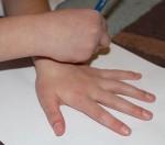 L tracing around her hand.