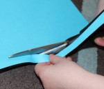 Cutting a strip of paper.