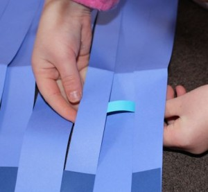 Weaving paper strips.