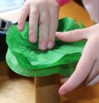 Adding more layers of tissue paper.