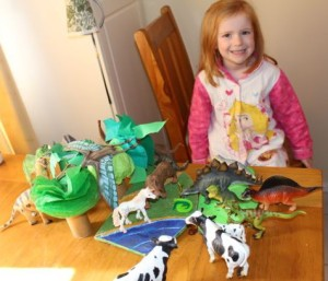 A very happy girl with her new trees and her animals.