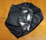 Tissue paper folded back on itself and taped to form a button.