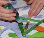 Adding glitter glue.