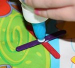 Gluing mini pop-sticks together.