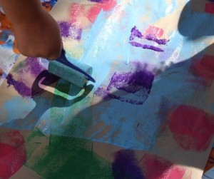 Rolling paint onto the paper.